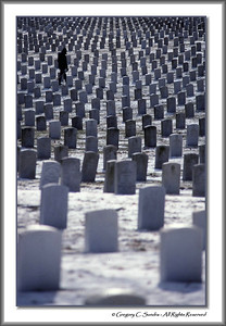 A lone maintenance worker walks among the thousands of grave markers at Dayton National Cemetery, Dayton, Ohio.