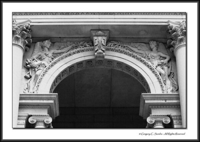 Corinthian and ionic capitals, arch and relief detail on the exterior of the Art Institute of Chicago.